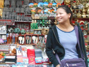 Smiling Chinese market seller after a fun haggling exchange.