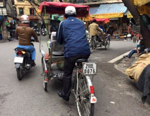 One of Hanoi's many cyclo drivers in the chaos that is Vietnam's roads!