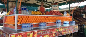 An orange juice vendor from Jemaa El Fnr. Fresh fruit juice is a feature of Moroccan cuisine.