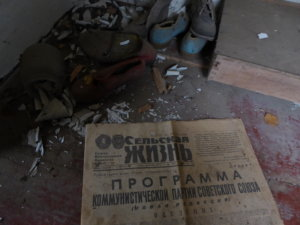 An old newspaper left in a deserted property gives some context to the timing of the event.