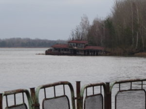 A once flourishing riverside restaurant crumbles into the surrounding water.