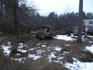 An old car sits abandoned in the Chernobyl exclusion zone.