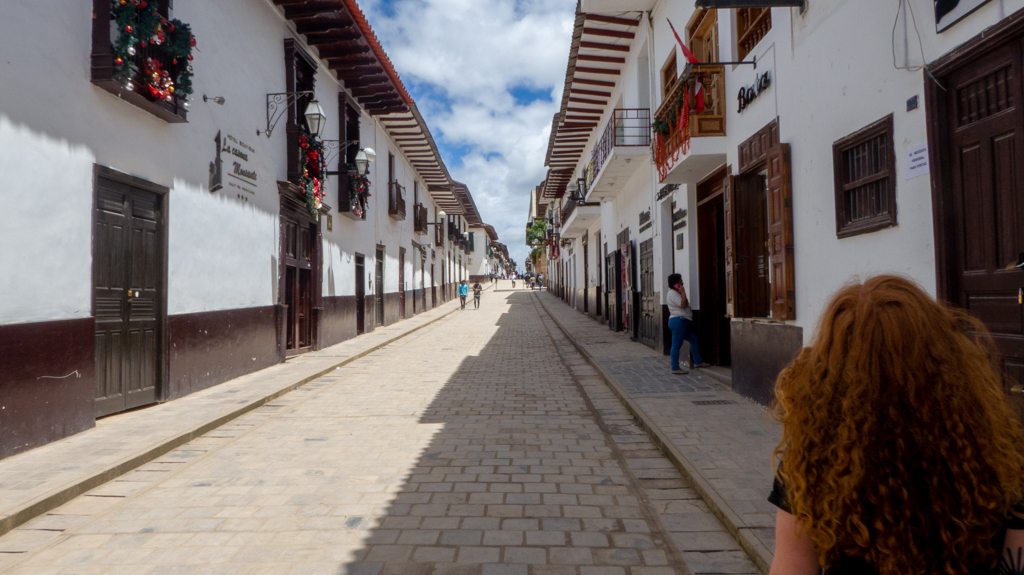 Girl walking down streets in Chachapoyas.