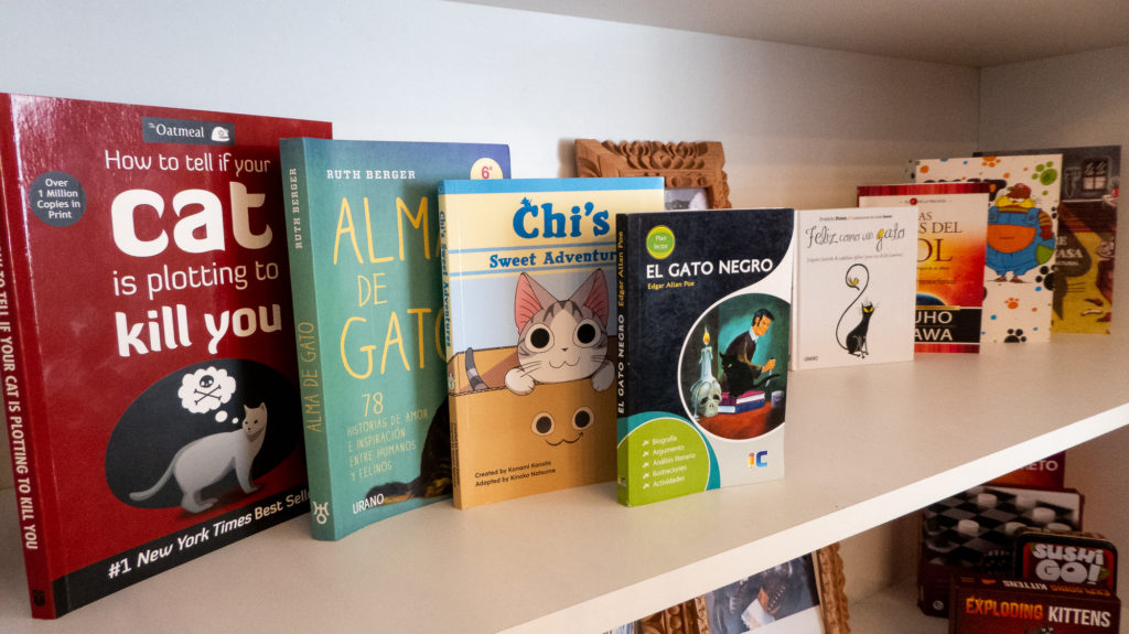 A selection of books at Cusco's cat cafe.