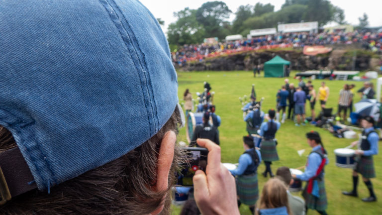 Spectators look in on the ring at the Highland games