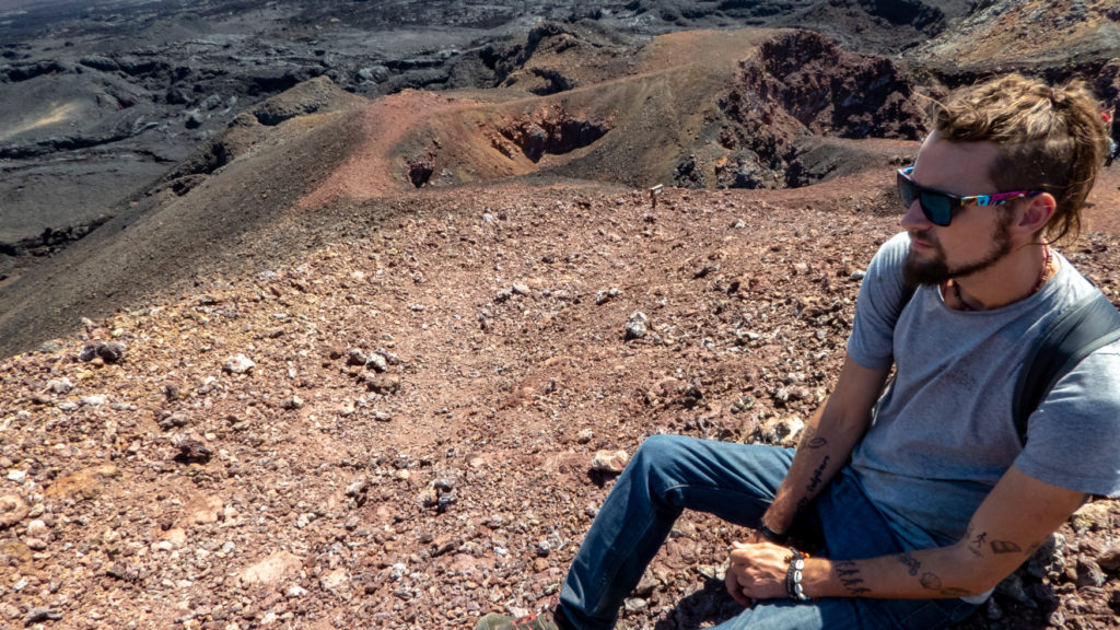Man sits on Volcán Chico and takes in views.