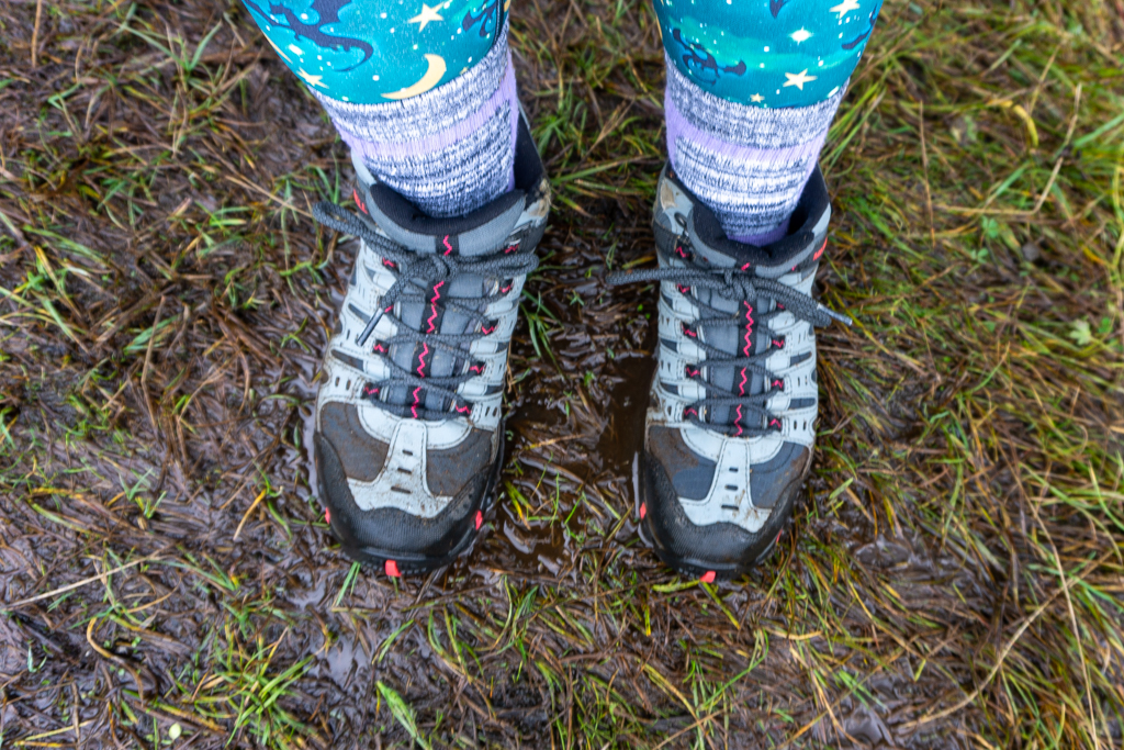 Hiking boots in muddy fieldHiking boots in muddy field