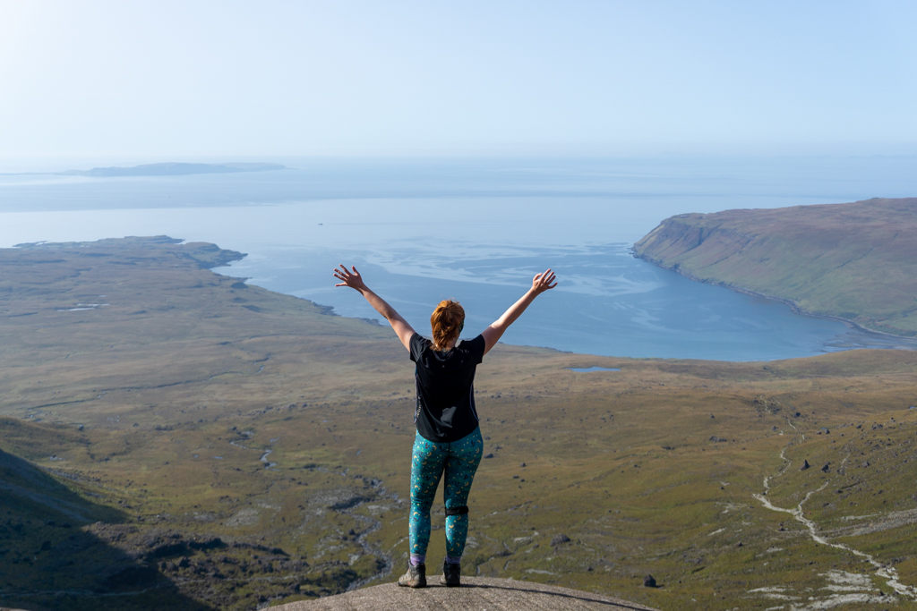 Girl posing with epic highland view